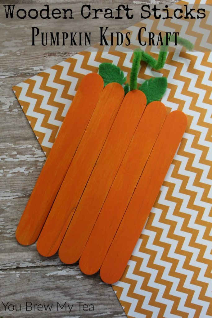 Craft Sticks make the perfect simple Pumpkin Kids Craft! Check out how to put this together to make a fun decoration or magnet for Fall!