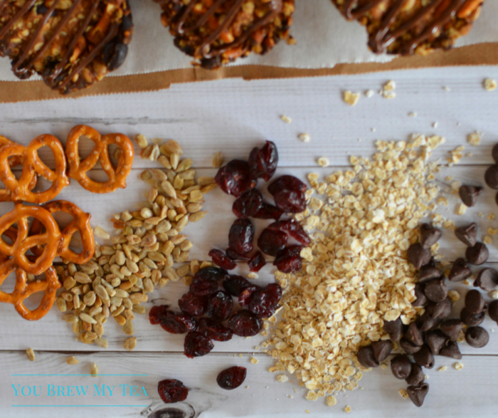 Granola Bar Recipes aren't boring anymore! Make our Chocolate Drizzled Granola Bar Rounds included sunflowers, chocolate, peanut butter, & cranberries!