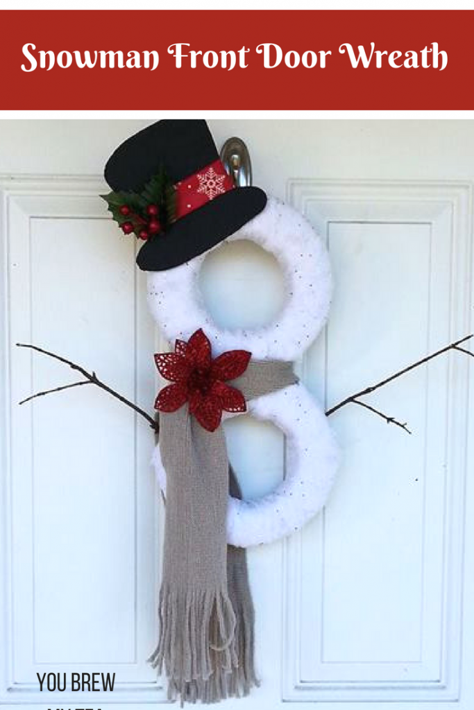 This DIY Snowman Wreath is so easy to put together and a great dollar store craft idea! This is a perfect holiday wreath that is under $5 out of pocket, and works all winter long!