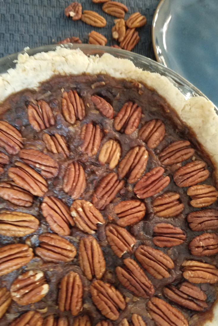 Vegan Pecan Pie is something you CAN make and enjoy! This version includes chocolate and coconut with a rich Medjool date base! Check out our recipe!