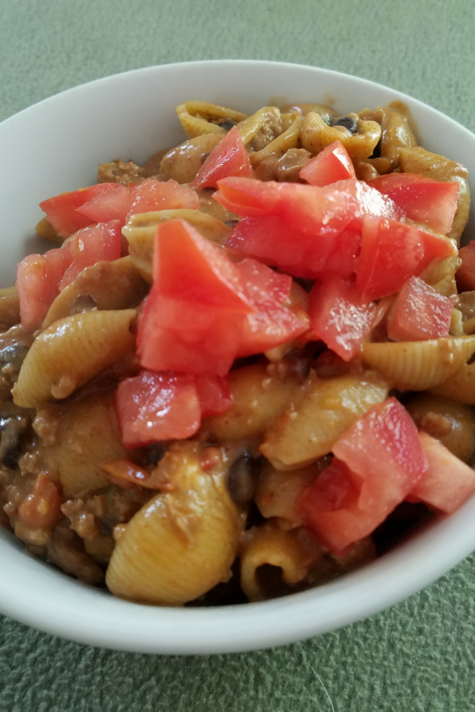 Make our Skinny Cheesy Taco Pasta dish for your family for only 6 SmartPoints on the Weight Watchers FreeStyle Plan! A great easy meal that the whole family loves and is ready in under 30 minutes!