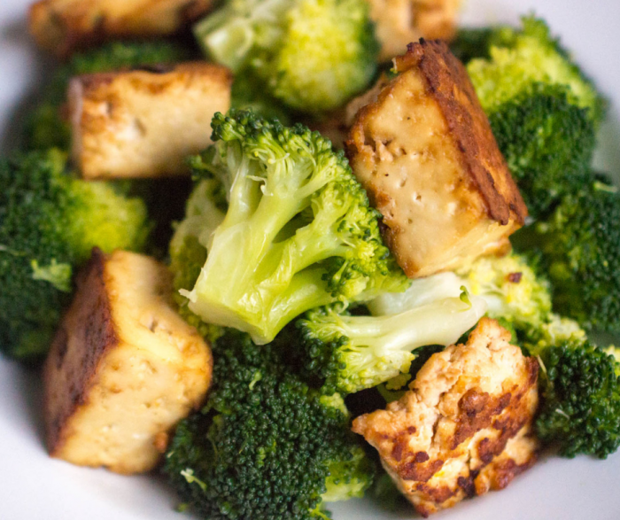 Up close image of a white bowl or plate filled with crispy tofu and broccoli